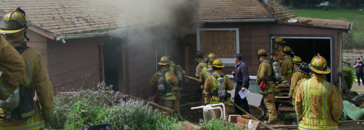 Fire Department personnel responding to house fire